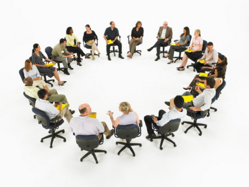 Group meeting forming circle, elevated view