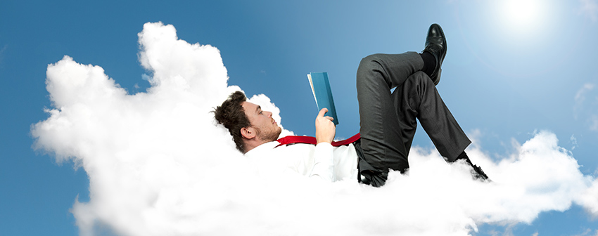 Businessman is reading a book on a cloud